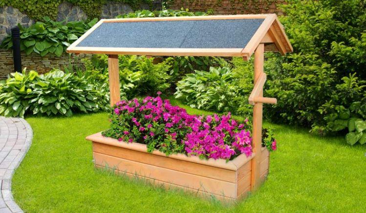 Der Holz Gartenbrunnen Kasan aus FSC zertifiziertem, tauchimprägniertem, honigbraunem Holz hat die Abmessung 95 x 50 x 80 cm