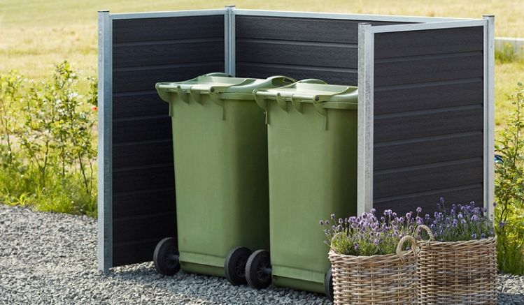 Pflegeleichte WPC Mülltonnenabtrennung im modernem skandinavischem Stil. Bausatz aus WPC Profilbrettern, Stahlrahmen und Pfosten. Kauf auf Rechnung  ✔