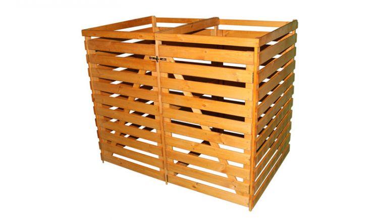 Die Mülltonnenbox aus honigbraunem Kiefern Holz für zwei Tonnen hat ein Maß von ca. 144 x 92 x 120 cm