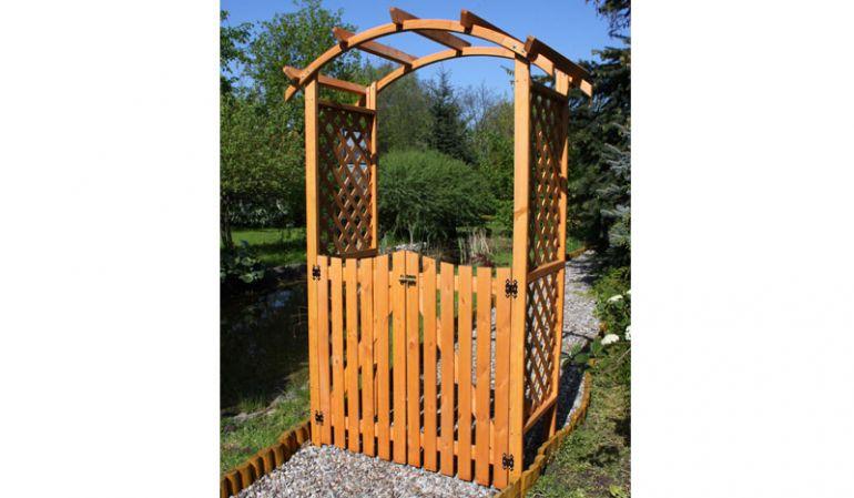 Der Pergola Bausatz Jakutsk hat das Maß 132 x 70 x 206. Die Türen sind inklusive. Gefertigt aus Kiefer / Fichte (Honigbraun)